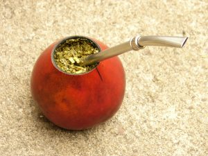 yerba mate in jar with straw